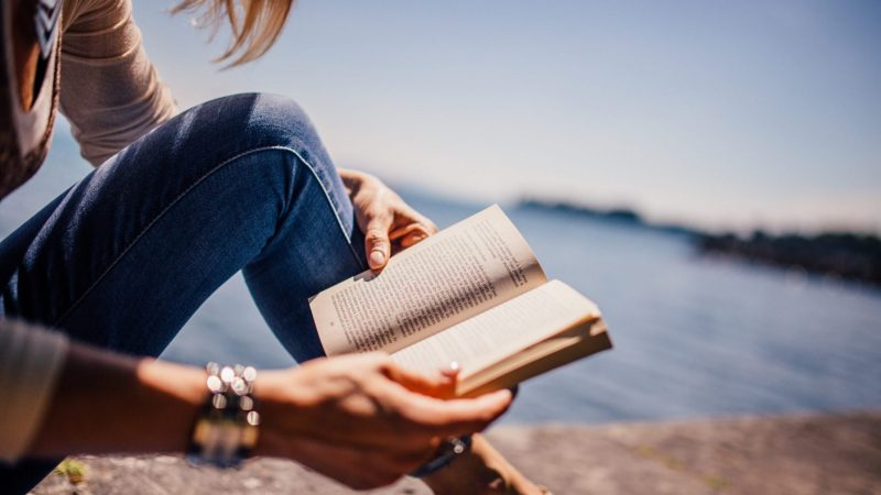 Woman reading godly book e1578559892727