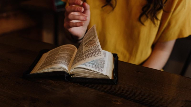 Woman reading the Bible (How Does the Bible Help With Depression?)