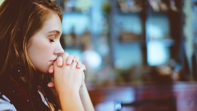 A woman praying -What is fear according to the Bible?